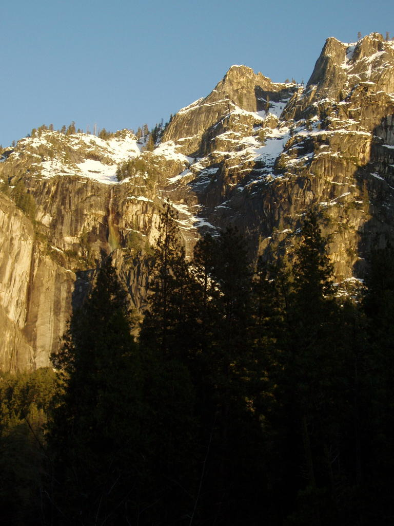 Snowy Yosemite Cliffs and Waterfall