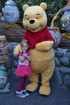 Ella poses with Pooh