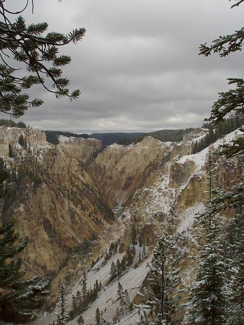 Grand Canyon of the Yellowstone River with fresh snow and threatening clouds