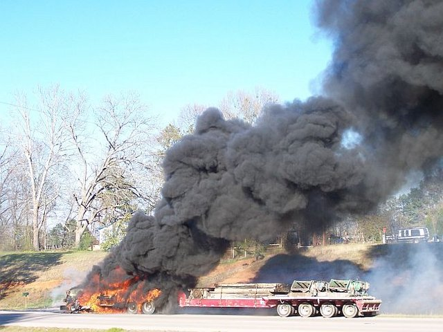 Truck engulfed by flames